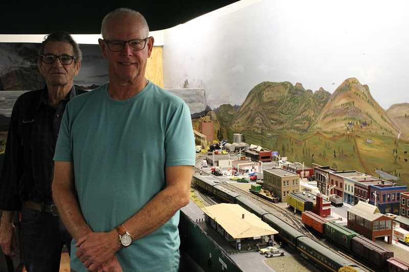 JASON CHANEY/CENTRAL OREGONIAN - Crooked River Model Railroad Club president Jim Davis (right) and member Roy Mackey stand near the Redmond display of the model where the club has added some new features, including streetlights.
