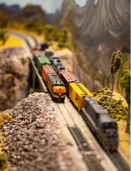 LON AUSTIN/CENTRAL OREGONIAN - A model train passes over a bridge on the working model of Central Oregon railways, which was on display during the Crook County Fair. The Crooked River Model Railroad Club maintains the model, which in located in a building on the Crook County Fairgrounds.