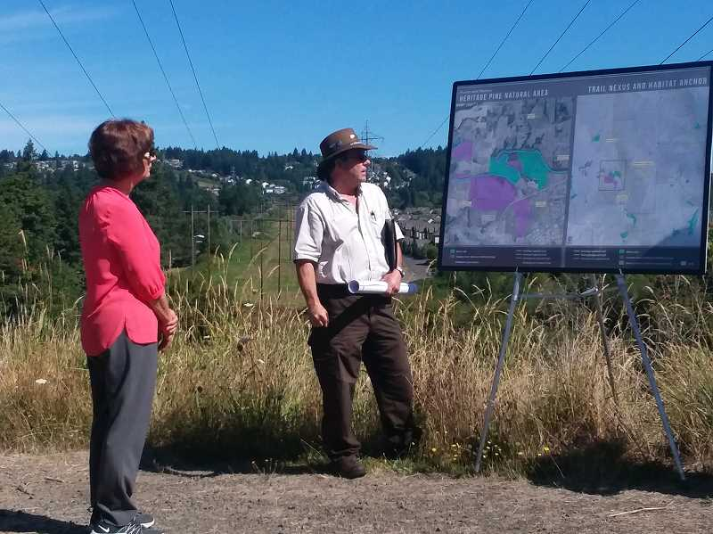 PMG PHOTO: RAY PITZ - Larry Klimek, refuge manager of the Tualatin River National Wildlife Refuge, explains the refuge system to U.S. Rep. Suzanne Bonamici during a tour of  Heritage Pine Natural Area on Aug. 14.