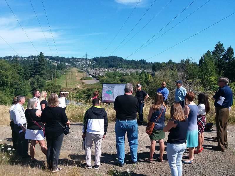 PMG PHOTO: RAY PITZ - Metro and local city officials took a tour of the expansive Heritage Pine Natural Area on Aug. 14, discovering how the area will become a future linchpin for connecting other regional trails in the area. The Tualatin River can be seen in the background.