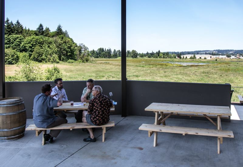 PMG PHOTO: JONATHAN HOUSE - The outdoor patio of Ancestry brewing looks out onto protected wetlands in Tualatin.