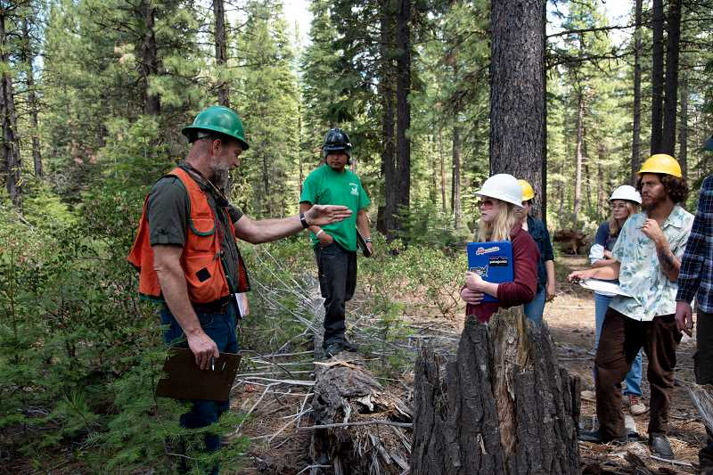 SUBMITTED PHOTO - COCC Professor Bret Michalski leads a recent forest entomology course as a part of the COCC forestry program. The program is one of only two associate degree programs in Oregon accredited by the Society of American Foresters.