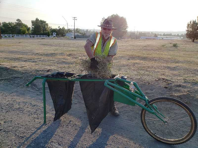SUBMITTED PHOTO - Gary Clowers, of Raven Research, is assisting the city in its efforts to eradicate weeds.