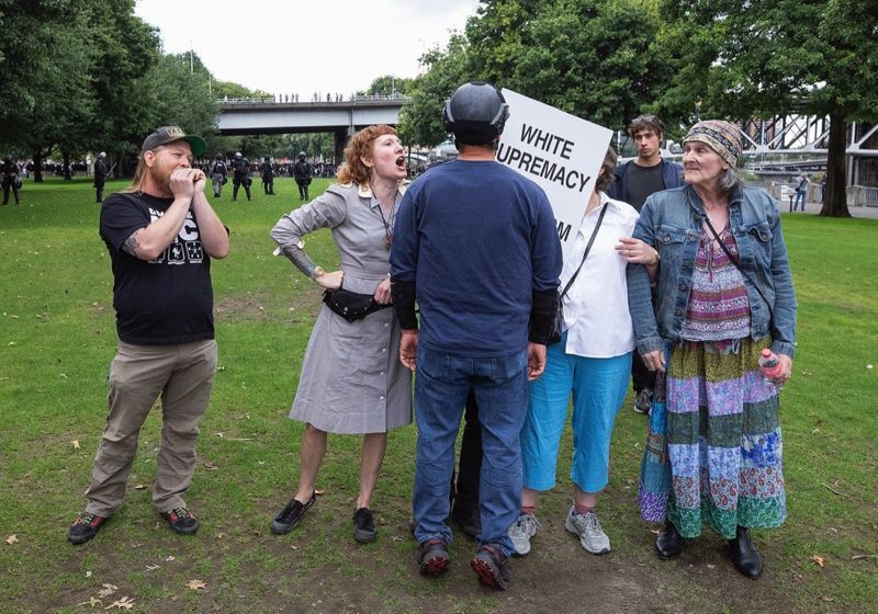 PMG PHOTO: JONATHAN HOUSE - Protesters get into each other's faces in Portland's Waterfont Park.