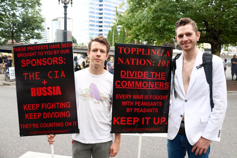 PMG PHOTO: ZANE SPARLING - Adam, left, and Josh Hamilton, said the demonstration in downtown Portland on Aug. 17 was a classic example of divide-and-conquer tactics by the government.