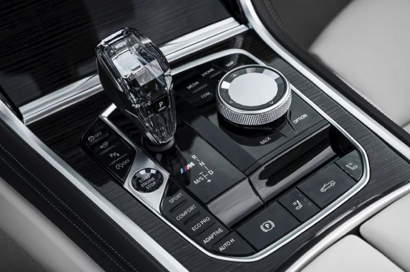 COURTESY BMW - The performance and infotainment system controls are located by the crytal gear shift knob on the center console.