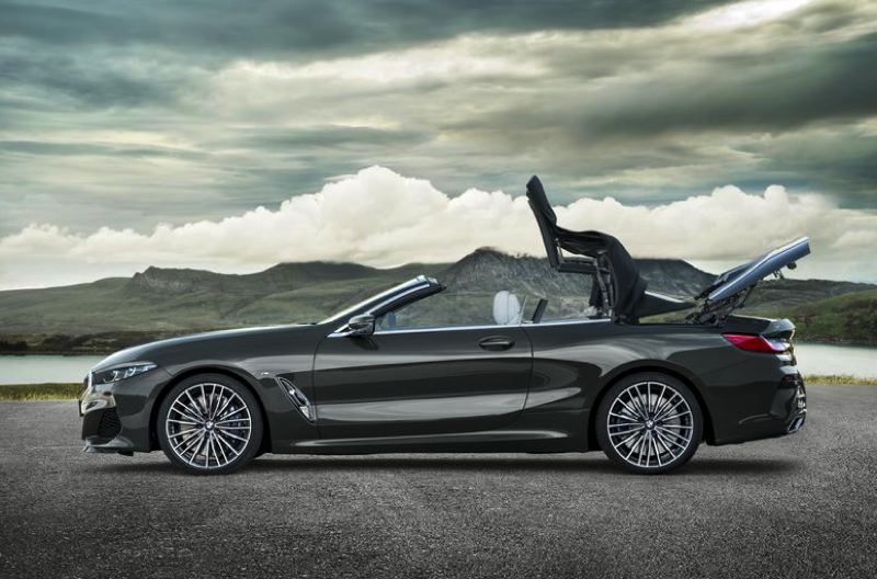 COURTESY BMW - The convertible top will fully retract behind rthe rear seats in 15 seconds at up to 30 miles per hour.