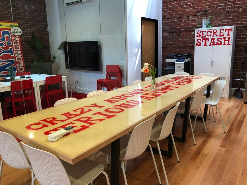 PMG PHOTO: STEPHANIE BASALYGA - One-third of the company's new Portland office is dedicated to a kitchen area, where employees gather at a large table every day to enjoy a company-provided lunch.