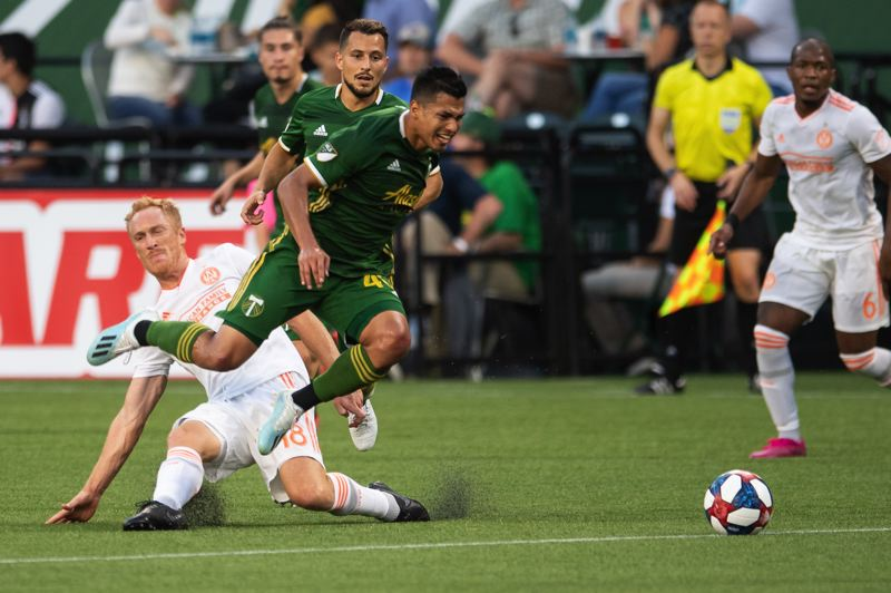 PMG PHOTO: CHRISTOPHER OERTELL - Portland Timbers midfielder Renzo Zambrano tries to make a move in the Sunday MLS game against Atlanta United at Providence Park.
