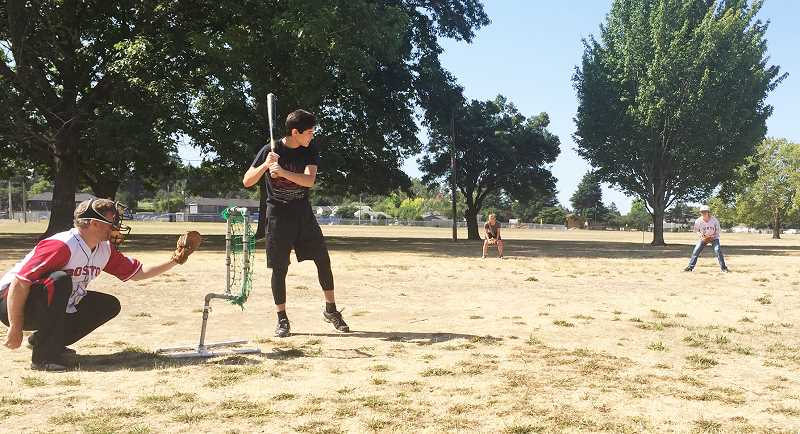 SUBMITTED PHOTO - Games of 21st Century Townball are played every Saturday during the summer at Renne Park in Newberg.