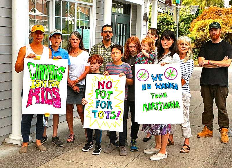 DAVID F. ASHTON - A group of neighbors and parents protested publicly at the site of Electric Lettuce Sellwood, a cannabis dispensary licensed to open near a preschool on S.E. 13th Avenue.