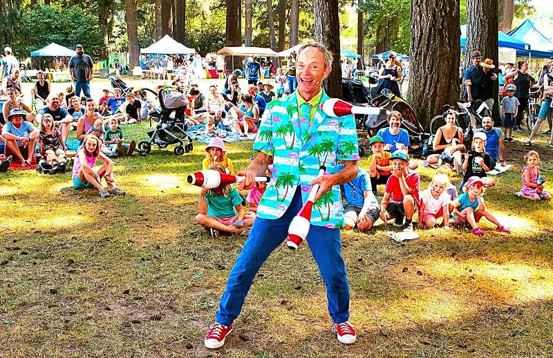DAVID F. ASHTON - Starting off his show at the 40th Sundae in the Park, widely-performing but Sellwood-based family entertainer Henrik Bothe juggles clubs.