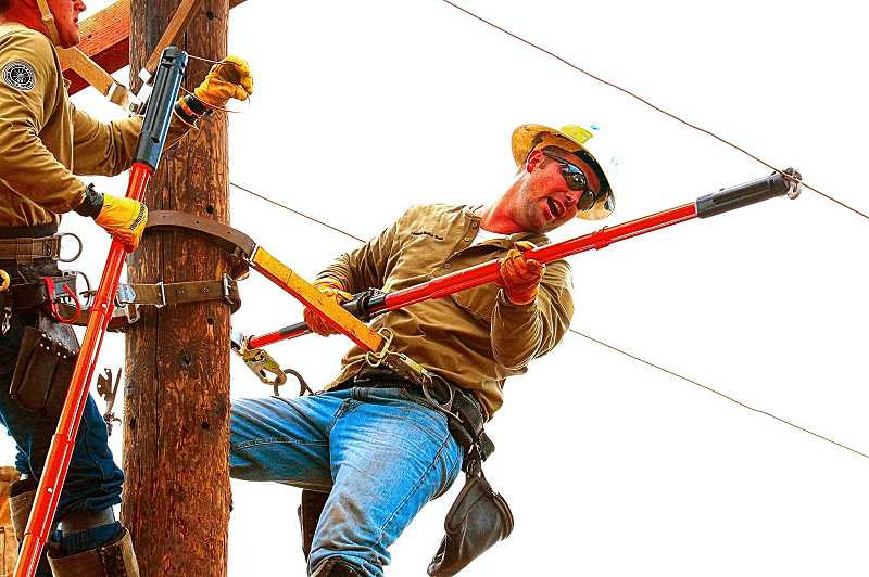 DAVID F. ASHTON - Brooklyn neighborhood PGE lineman Colten Hevern competed in the Insulator Change-out challenge.