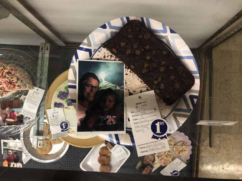 PMG PHOTO: NOAH WASS - Molalla resident Lorin Wilson and her child won the blue ribbon for their chocolate banana cake in the Baking Buddies contest at the fair.