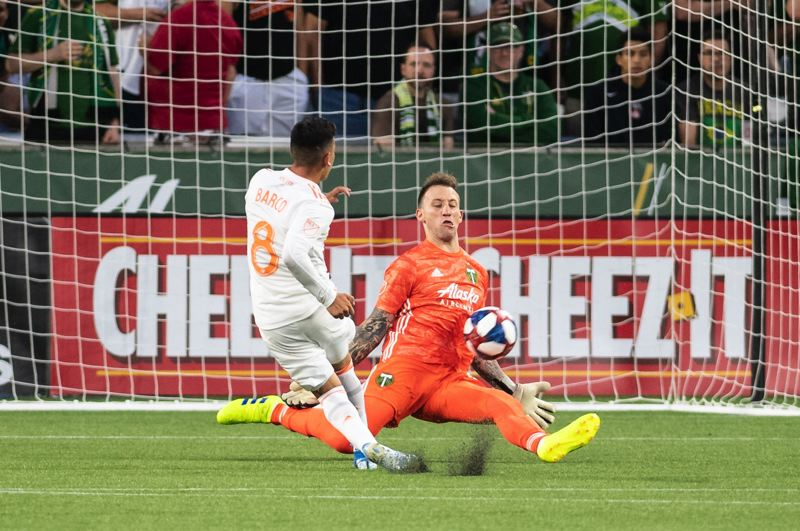PMG PHOTO: CHRISTOPHER OERTELL - Portland Timbers goalkeeper Steve Clark comes out to stop Atlanta United midfielder Ezequiel Barco during Sunday's 2-0 Timbers defeat at Providence Park.