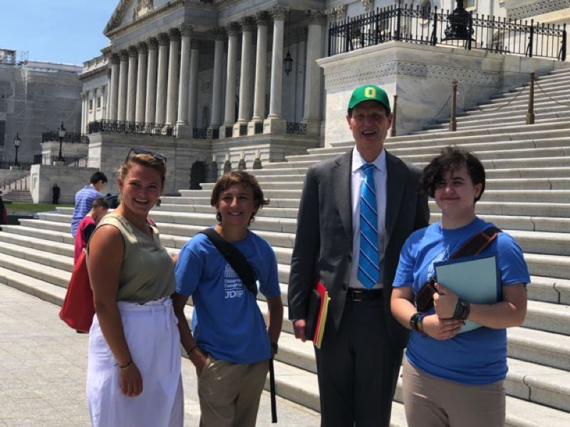 COURTESY PHOTO - Oregon City's Ellie Carlson meets with (from right) U.S. Sen. Ron Wyden, D-Oregon, fellow Oregon Children's Congress delegate Bram Gerken of Bend, and Type 1 diabetes role model Fiona Wylde.
