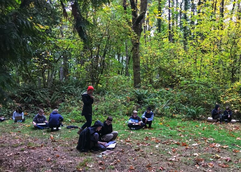 COURTESY PHOTO - Gardiner Middle School students write reflections of their field trip to the area around Newell Creek and time spent in nature.
