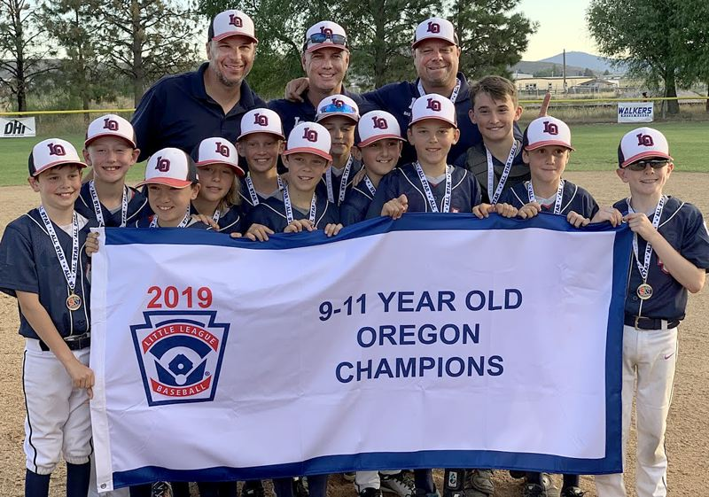 COURTESY PHOTO - The Lake Oswego 11U baseball all-star team poses with its championship banner after winning the Oregon state title at the end of July in Klamath Falls.