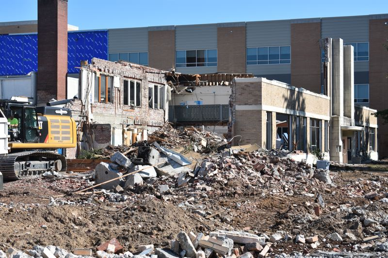 PMG PHOTO: TERESA CARSON - The demolition of the 1940s Works Progress Administration-built section of Gresham High School nears completion. Part of the old front entrance is still standing in this shot, with the new school building in the background.