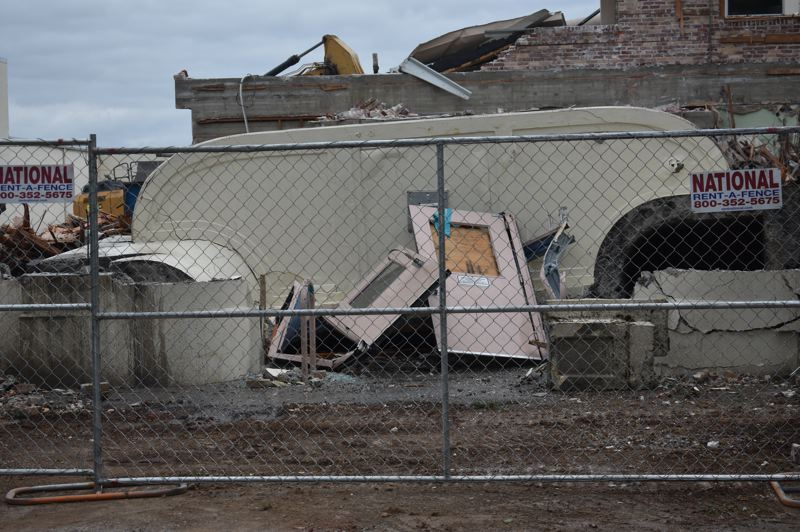 PMG PHOTO: TERESA CARSON - The Gresham High School entrance section was pulled down Friday, Aug. 16. Here the doors lie askew with the curved canopy above the doors behind them.
