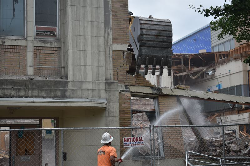 PMG PHOTO: TERESA CARSON - Workers take down what used to be the office and entrance of Gresham High School.