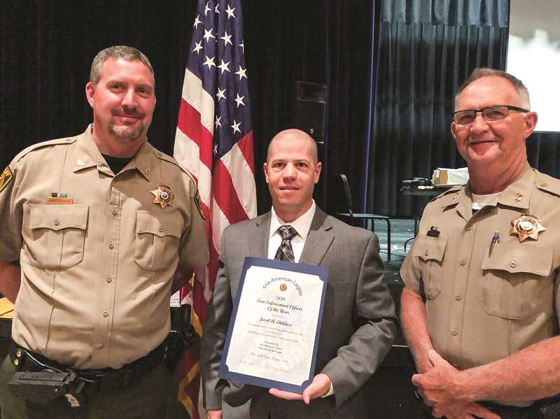 PHOTO SUBMITTED BY JAMES SAVAGE - Sgt. Jacob Childers of Crook County Sheriff's Office (center) poses for a photo with Undersheriff James Savage (left) and Sheriff John Gautney after being recognized as the Law Enforcement Officer of the Year by the American Legion at its state event.