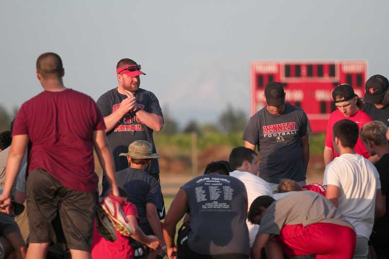 PMG PHOTOS: PHIL HAWKINS - Head coach Joe Panuke addresses the team after one of last week's fall camps.