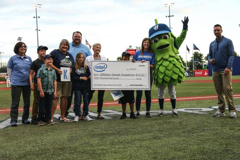 COURTESY PHOTO: HILLSBORO HOPS - Representatives from the Hillsboro Schools Foundation receive a $50,000 check from Intel Corp. from Barley the Hop, mascot for the Hillsboro Hops, during a game Saturday, Aug. 17.