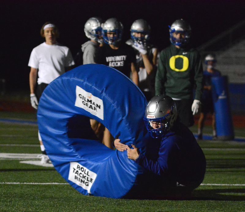PMG PHOTO: DAVID BALL - Gresham players go through a tackling drill during Mondays midnight practice, officially starting their 2019 season at 12:01 a.m. Monday under the lights at Stapleton Field.