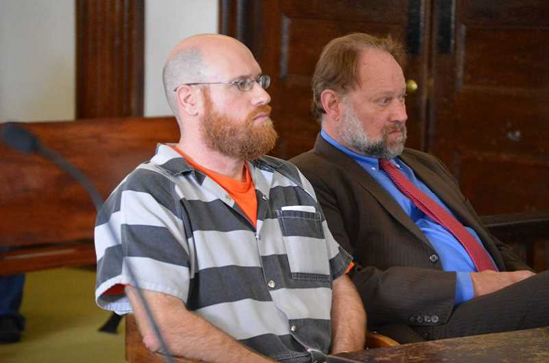 PMG PHOTO: NICOLE THILL-PACHECO - Kyle Jarred Wroblewski, 45, left, sits with his lawyer, David McDonald, on Monday, Aug. 19, during a sentencing hearing in Columbia County Circuit Court. Wroblewski was sentenced to 50 months in prison after pleading guilty to five counts of sex abuse in the second degree.