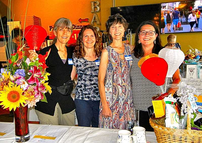 ELIZABETH USSHER GROFF - The major organizers for the Leukemia and Lymphoma Society silent auction at Pizza Roma in Woodstock on August 7 were, from left: Patty Bauer, Stacy Owen, Mary Rower, and Kristi Lopakka.