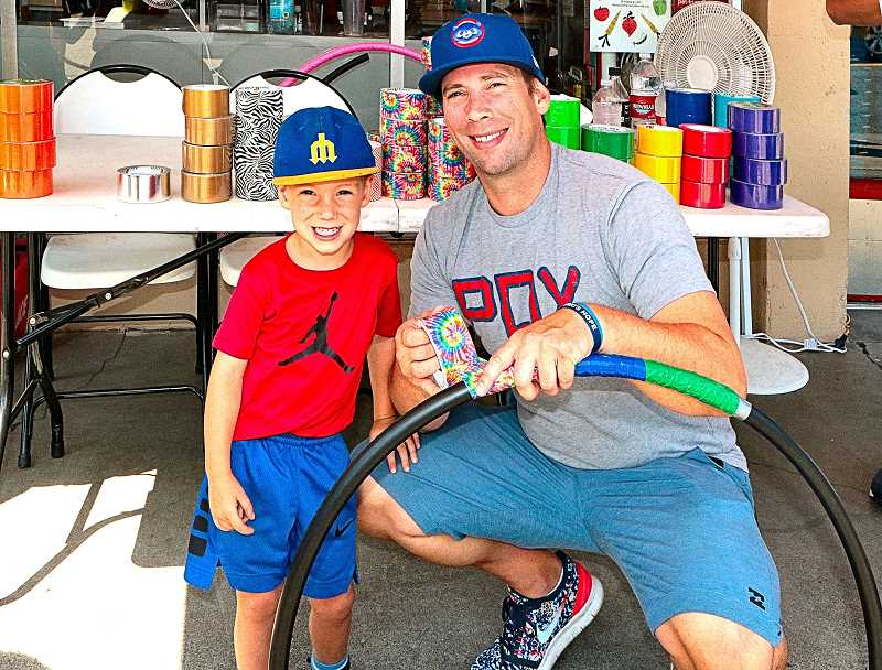 DAVID F. ASHTON - At this Summerville location, Westmoreland Ace Hardware, Ryne Elliott and dad Todd decorated free hula hoops provided by the store.