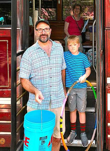 DAVID F. ASHTON - Stepping from the Summerville Trolley, Carey and Aidan Caldwell headed off to explore more of the days free activities in Sellwood and Westmoreland.