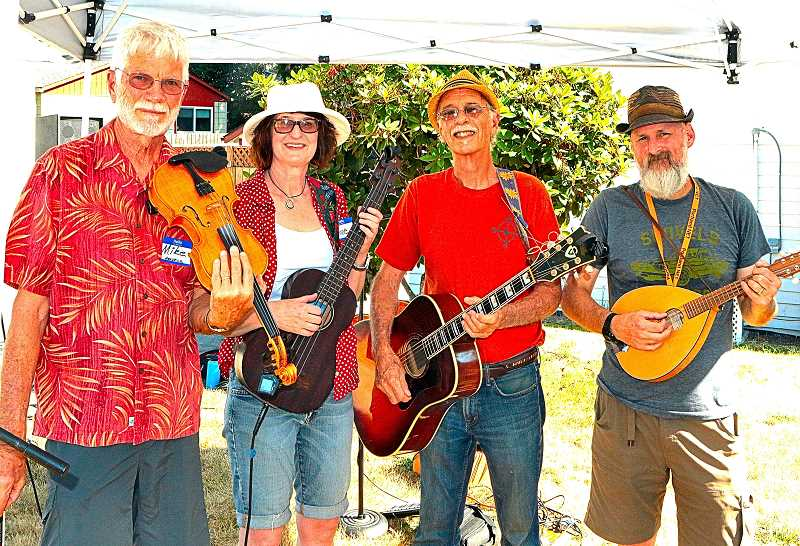 DAVID F. ASHTON - A local band known as the Reed Ramblers - with Mike Headrick on fiddle, RNA Chair Anne Tillinghast playing the bass ukulele, John Fraser on guitar, and Todd Kelley playing mandolin - performed lively folk music at this summers Reed Neighborhood Picnic.