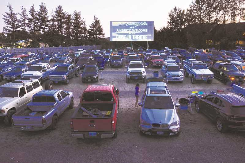 GRAPHIC PHOTO: GARY ALLEN - The movie line-up at the 99W Drive-In begins with an announcement from the operation's owner, Brian Francis, followed by some quaint historic footage.