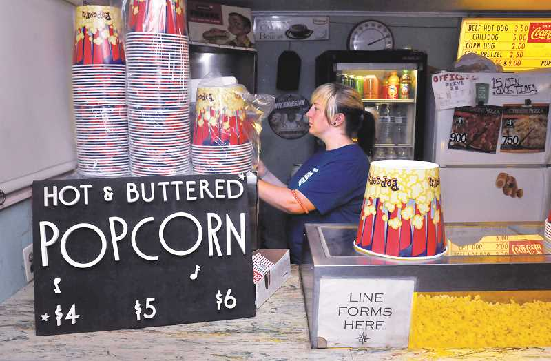 GRAPHIC PHOTO: GARY ALLEN - The drive-in experience would be incomplete without a trip to the snack bar.