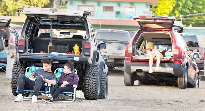GRAPHIC PHOTO: GARY ALLEN - The favorite manner to watch movies at the drive-in is to back in a pickup or SUV and take in the show.