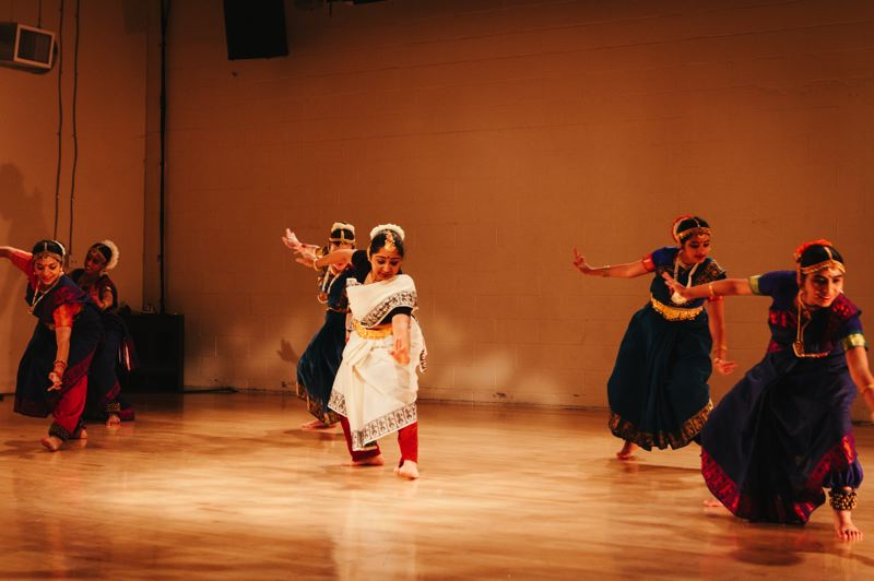 COURTESY PHOTO  - Portlands Cultural Laureate Subashini Ganesan, center, leads a group of dancers in one of the many styles of dance to be presented on Sunday, Aug. 25, at the Gresham Library.
