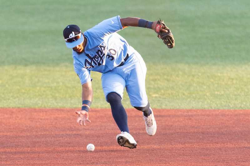 PMG PHOTO: CHRISTOPHER OERTELL - Hillsboro Hops infielder Eddie Hernandez (30) during a game against the Boise Hawks at Ron Tonkin Field in Hillsboro on Wednesday, Aug. 14.