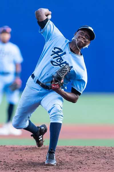PMG PHOTO: CHRISTOPHER OERTELL - Hillsboro Hops pitcher Wilfrey Cruz (27) during a game against the Boise Hawks at Ron Tonkin Field in Hillsboro on Aug. 14.