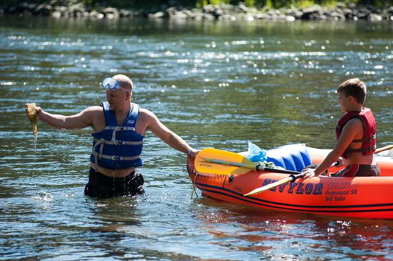 COURTESY PHOTO - Working from boats is one way that participants in the annual Down the River Cleanup remove trash from the Clackamas River.