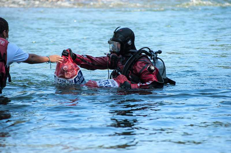 COURTESY PHOTO - Participants in the Down the River Cleanup often search for trash while scuba diving.