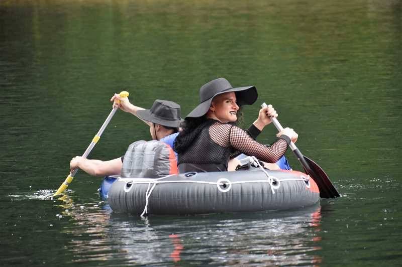 PMG PHOTO: EMILY LINDSTRAND - Members of Portland's gothic community took to the Clackamas River for a float on Saturday, Aug. 17.