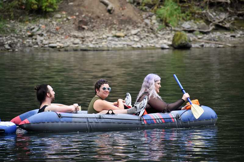 PMG PHOTO: EMILY LINDSTRAND - Participants in last weekend's goth float begin their journey along the Clackamas River.