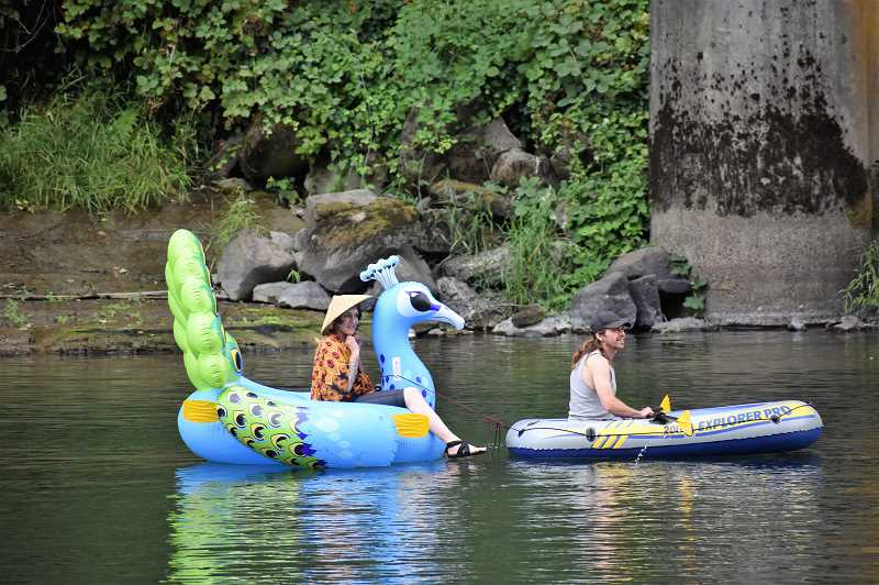 PMG PHOTO: EMILY LINDSTRAND - A variety of floatation devices were used during the fifth annual Goth Float on the Clackamas River on Saturday, Aug. 17.