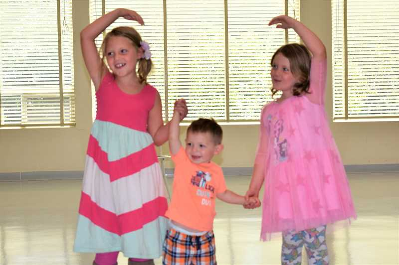 PMG PHOTO: EMILY LINDSTRAND - Harlie, Wesley and Abby Wunische will sing and dance in the upcoming Touch of Class fundraiser for the Estacada Community Centers Meals on Wheels program.