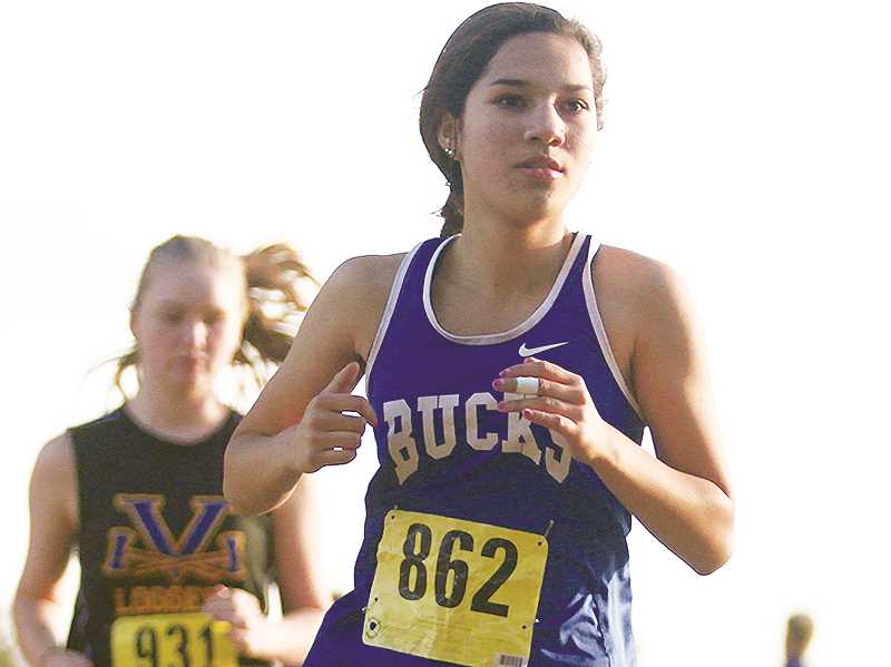 WOODBURN INDEPENDENT FILE PHOTO - Senior Jackie Diaz is steadily improving her times this fall.
