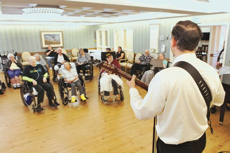 PMG PHOTO: JAIME VALDEZ - John Van Beek performs before an appreciative audience at the West Hills Health and Rehabilitation Center in Southwest Portland.