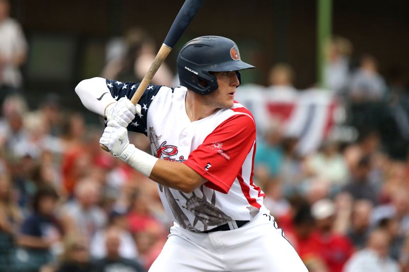 PHOTO COURTESY OF GATEWAY GRIZZLIES - Sherwood High School graduate Zak Taylor, wearing a special stars-and-stripes jersey, gets ready to take a swing for the Gateway Grizzlies during a July 3 game against the Evansville Otters.