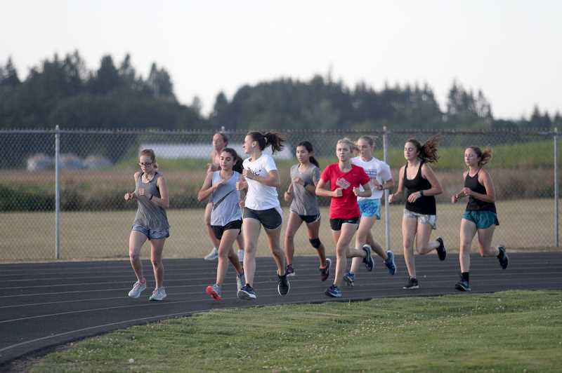 PMG PHOTOS: PHIL HAWKINS - The Trojans have more than a dozen girls signed up to participate in the coming fall season, giving Kennedy one of the biggest girls teams in the state at the 2A level.